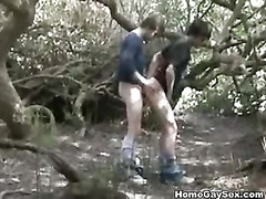 Boys drilling each others ass in the forest