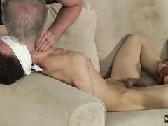 Blindfolded boy receives good handjob & a kiss