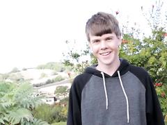 8teenboy smiles and examines his nice ram rod