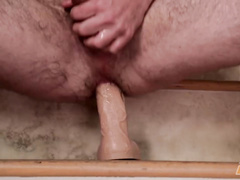 Sexy handsome brunette twink jerks off dick and rides dildo