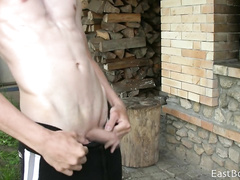 White skinny twink is undressing and posing outdoors