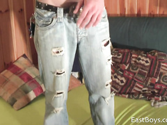 Young gay is posing in cool jeans before wanking dick